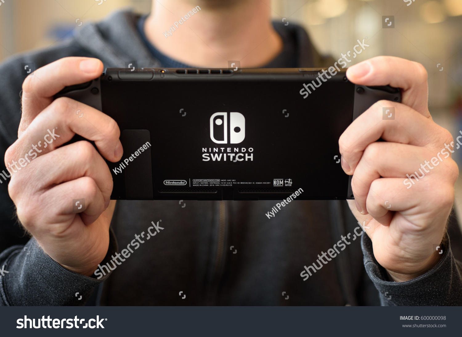 Man Holding Nintendo Switch Console Brewster Stock Photo Edit Now