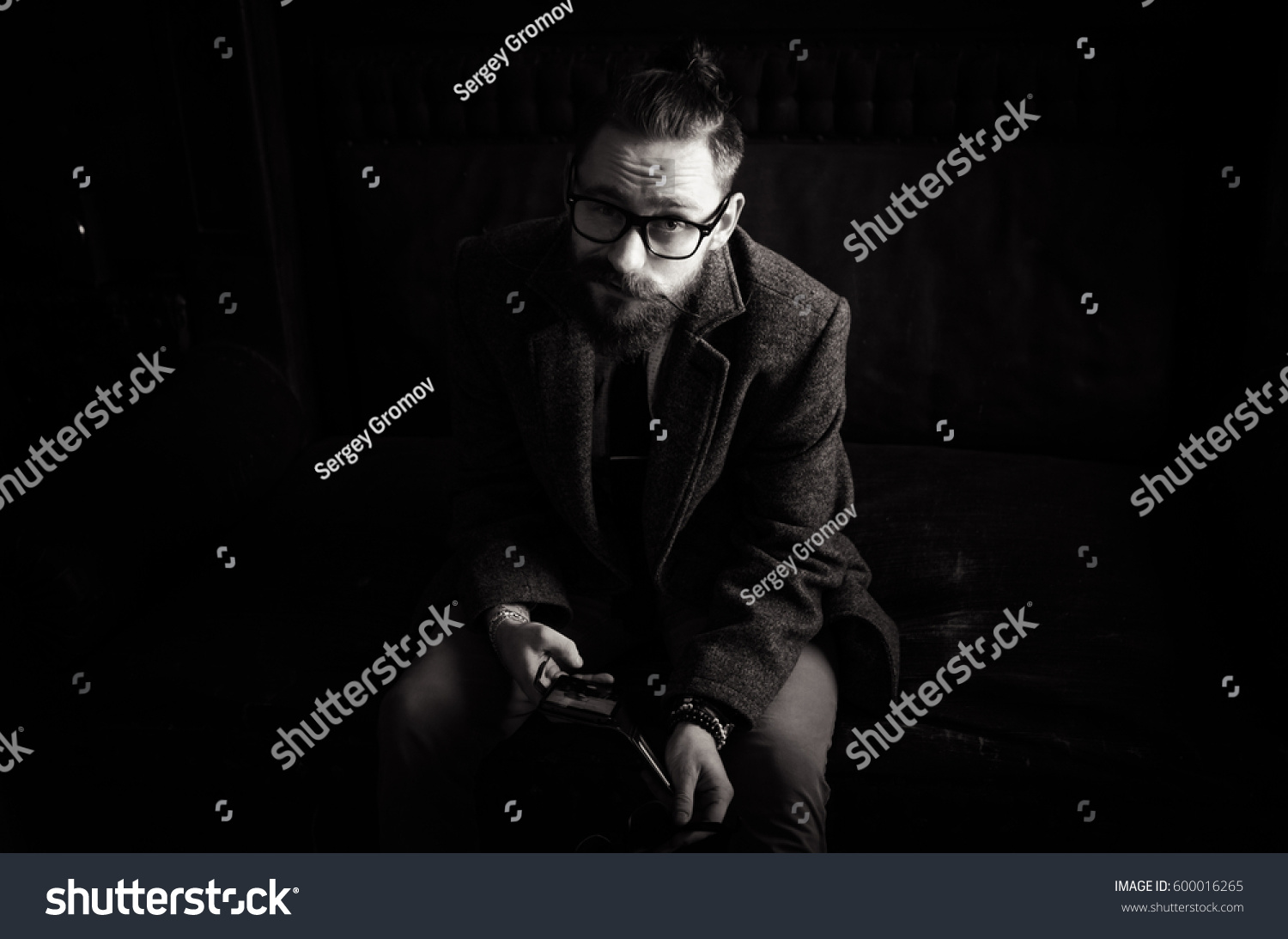 Black and white Portrait of handsome adult man sending a text message,business  man reading