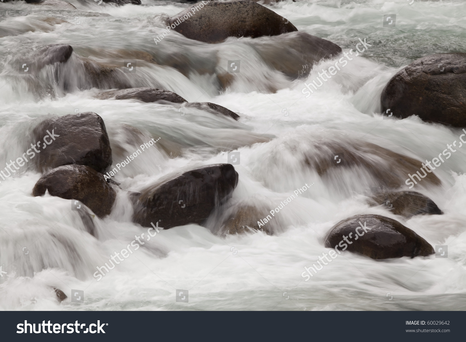 River Blured And Looking Peaceful Rolling Over Rocks