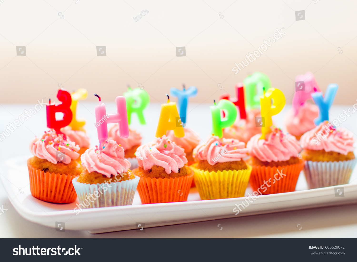 Colorful Birthday Cupcakes With Candles