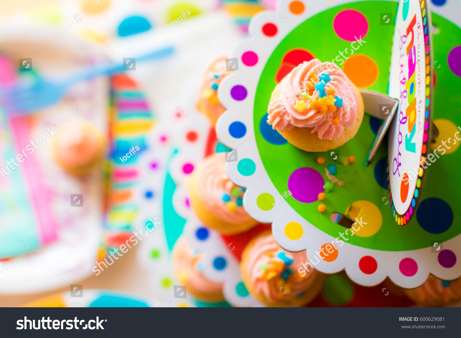 Colorful Birthday Cupcakes On A Cupcake Stand