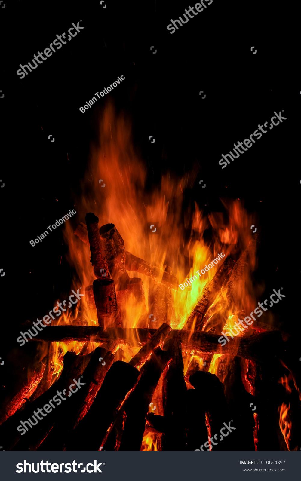 bonfire beach night stock photo (edit now) 600664397 - shutterstock
