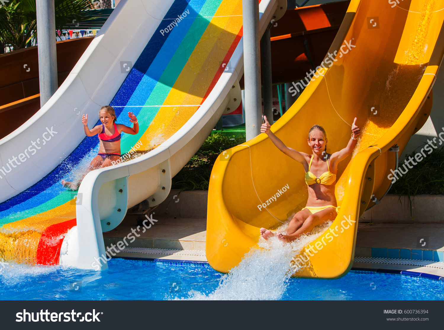 swimming pool slides children on water stock photo 600736394