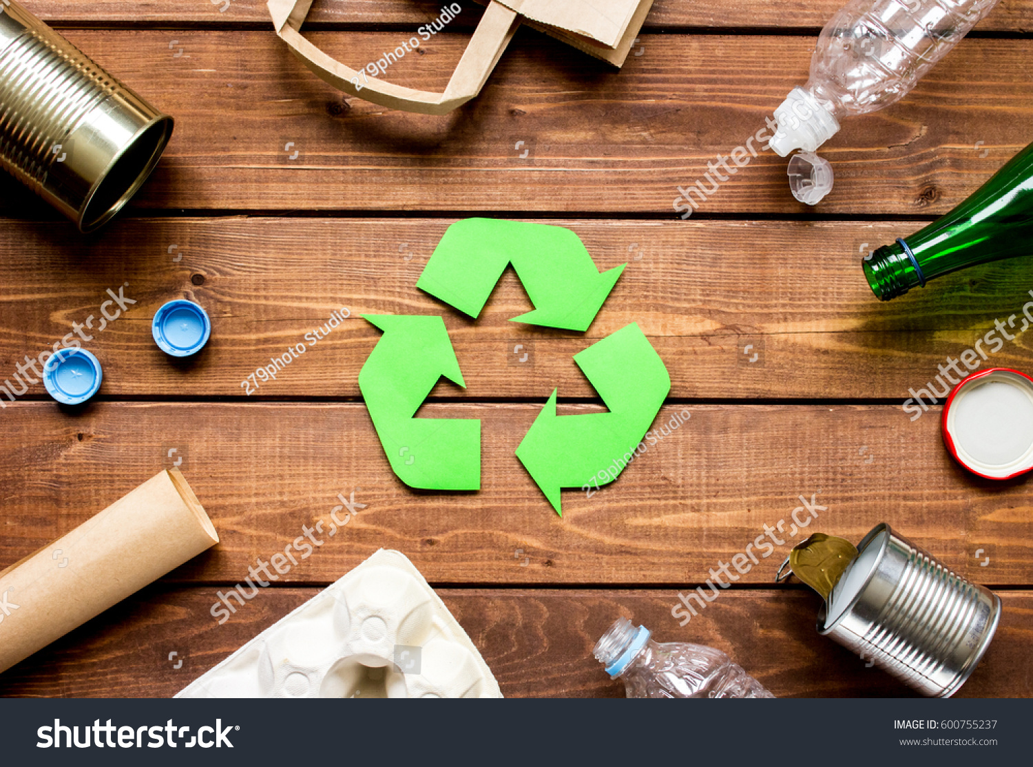 Eco concept with recycling symbol on table background top view #600755237