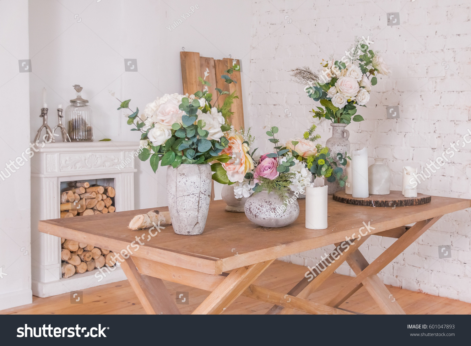 Flowers decoration shop different vases spring stock photo flowers decoration shop different vases with spring sommer flowers on the wooden table fireplace junglespirit Gallery