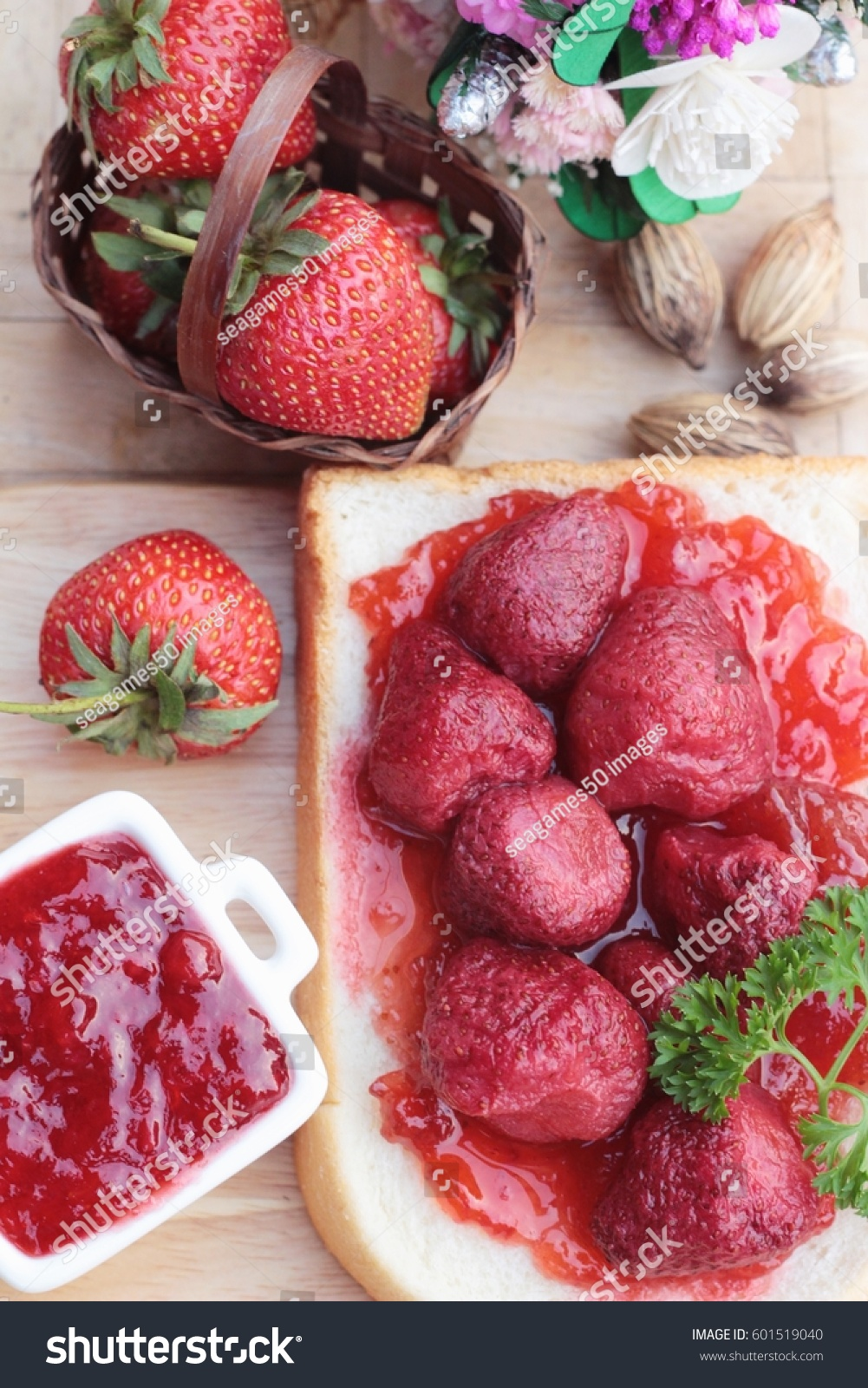 Strawberry jam with slice of bread delicious #601519040