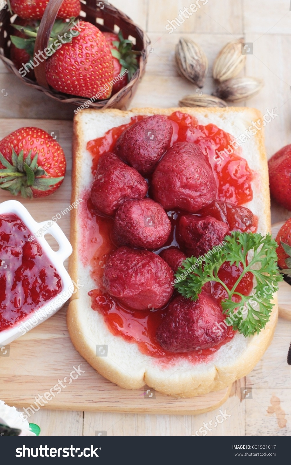 Strawberry jam with slice of bread delicious #601521017