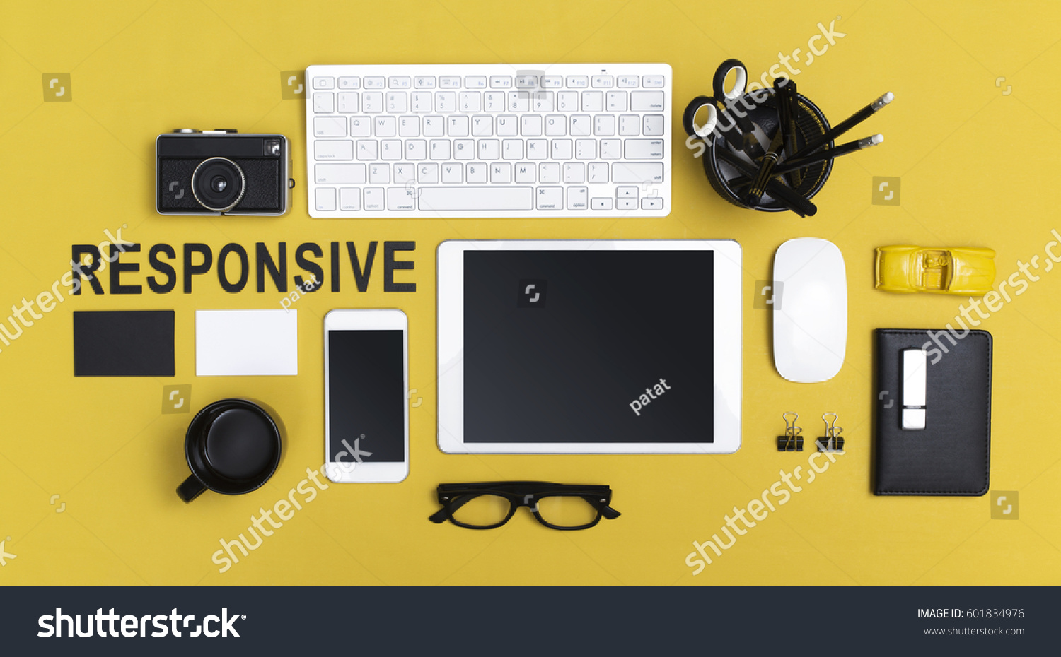 responsive design mockup for tablet and smartphone on yellow background #601834976