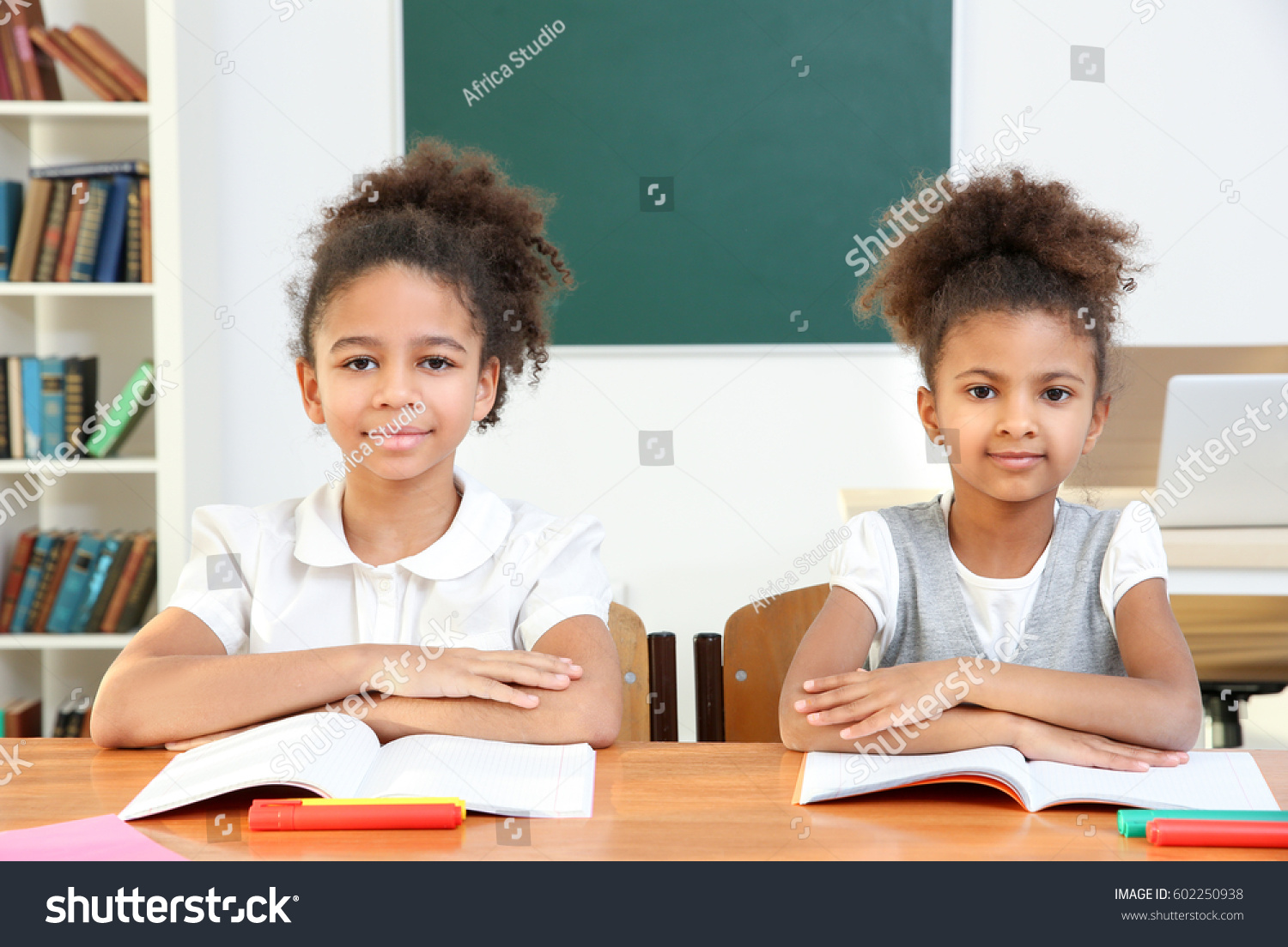 Beautiful Elementary Classrooms ~ Beautiful elementary schoolgirls studying classroom stock