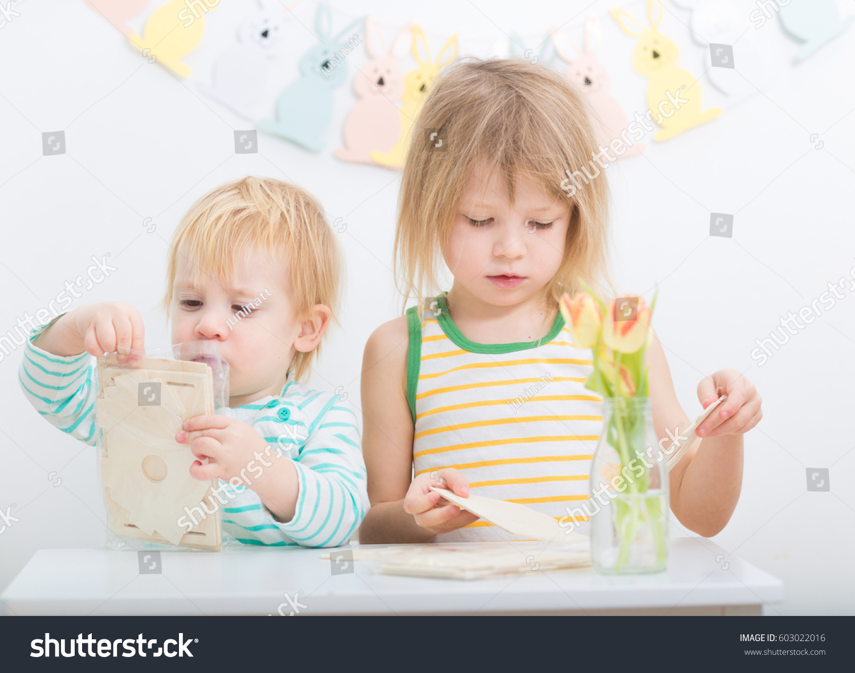 Learning Toys Toddler Girl : Baby toddler boy older girl exited stock photo