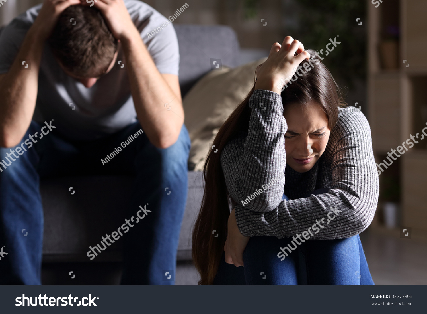 sad couple after argument breakup sitting stock photo 603273806