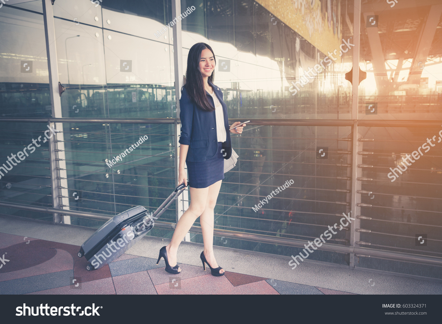 asia businesswoman on commute transit talking stock photo 603324371 shutterstock. Black Bedroom Furniture Sets. Home Design Ideas