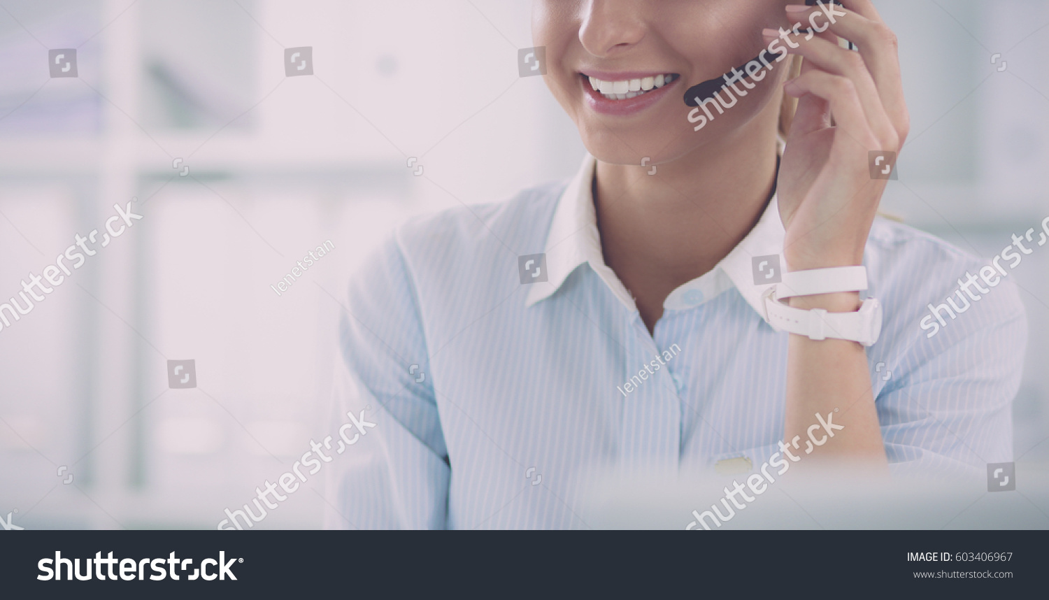 portrait of a customer service agent sitting at office #603406967
