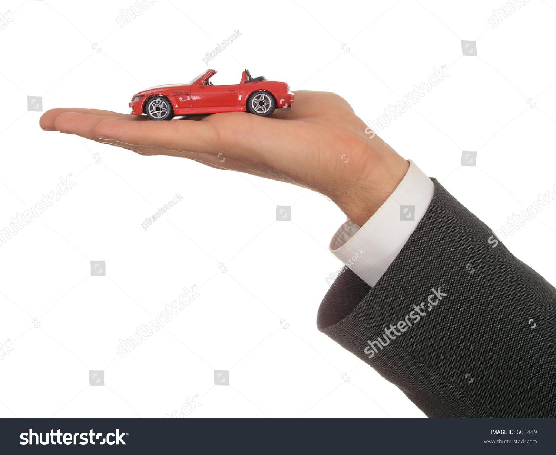 Technology Management Image: Businessman'S Hand Holding Toy Car Stock Photo 603449