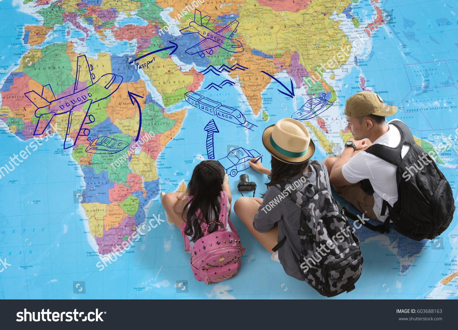 Family planning trip around worldtheyre looking stock photo royalty the family is planning a trip around the worldeyre looking at a gumiabroncs Choice Image