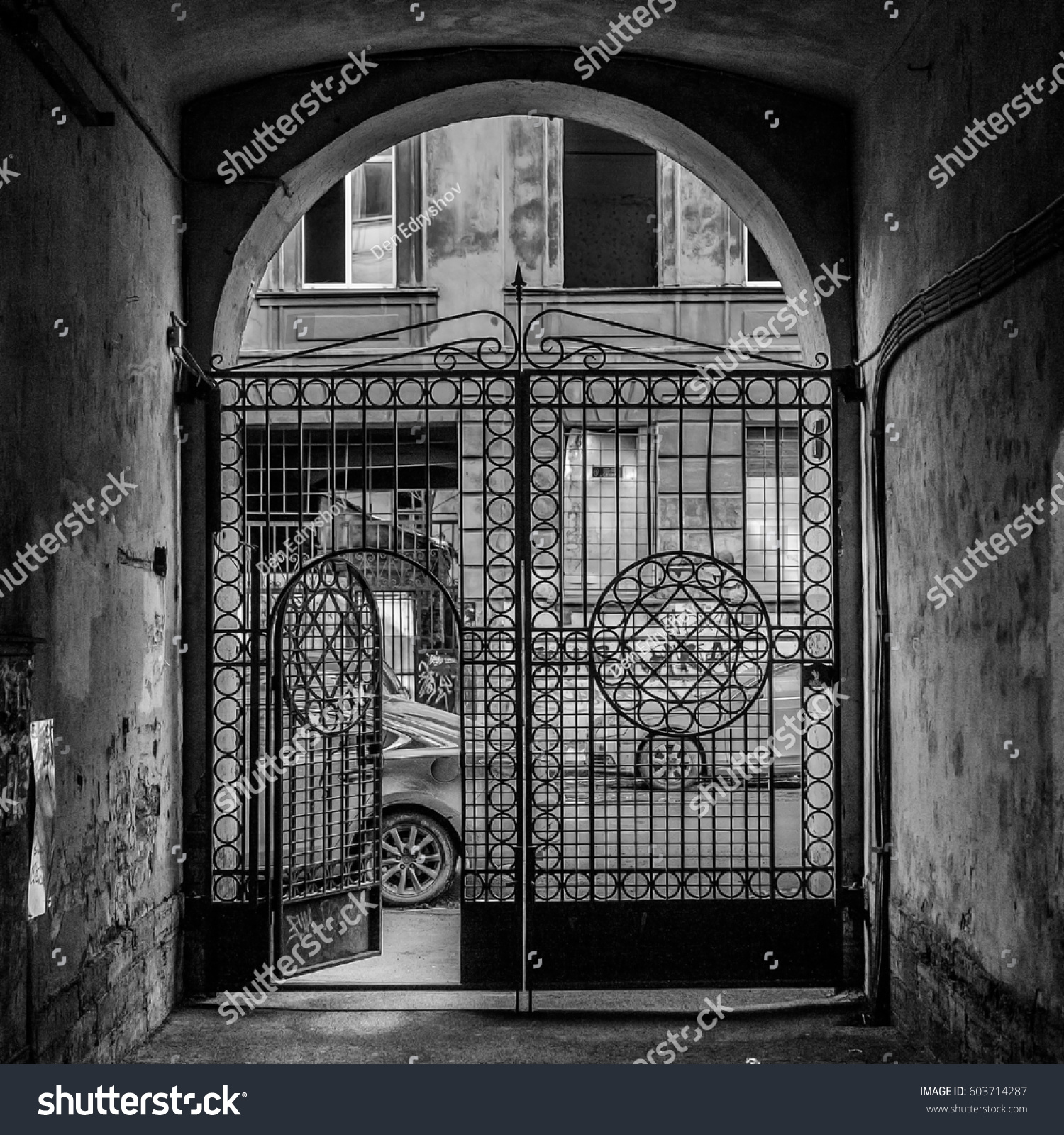 Vintage gates of small courtyard with forged lattice