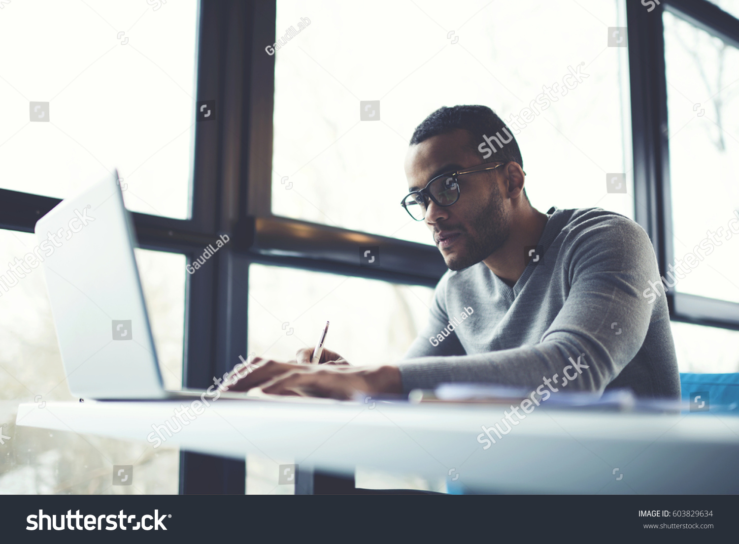 Skilled Afro American Male Professional Freelancer Stock