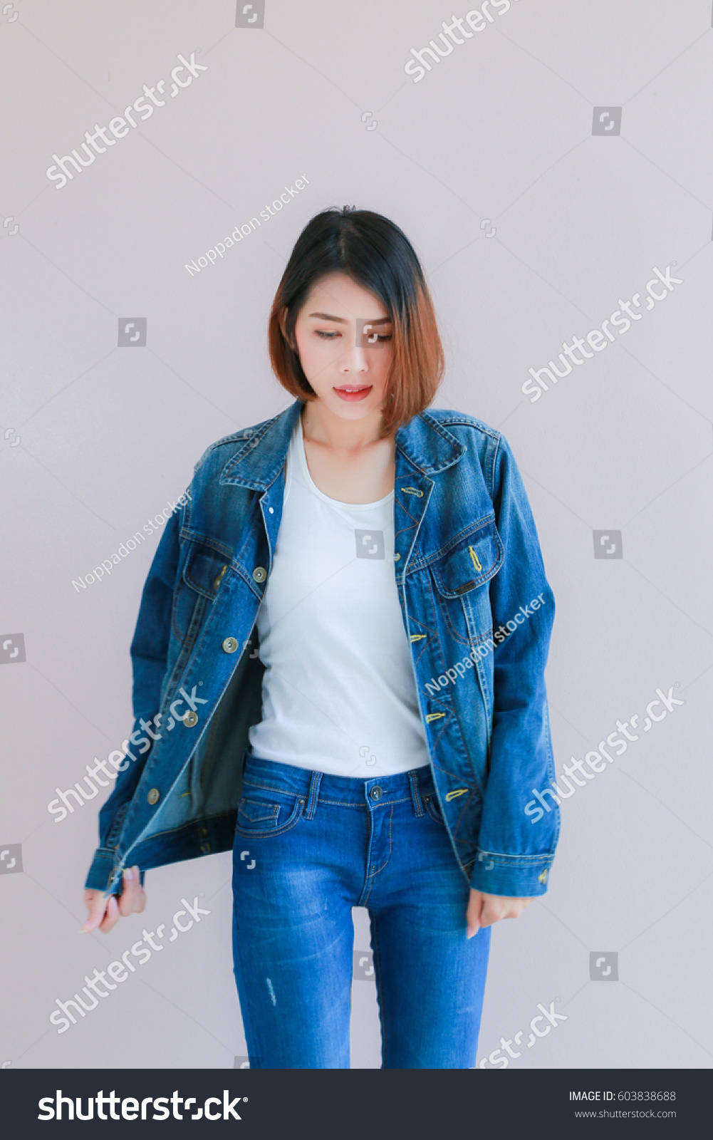 9199ab88c0 Closeup Asian woman casual outfits standing in jeans and blue denim shirt