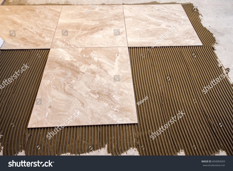 Ceramic tiles tools tiler floor tiles stock photo 604083659 ceramic tiles and tools for tiler floor tiles installation home improvement renovation dailygadgetfo Image collections