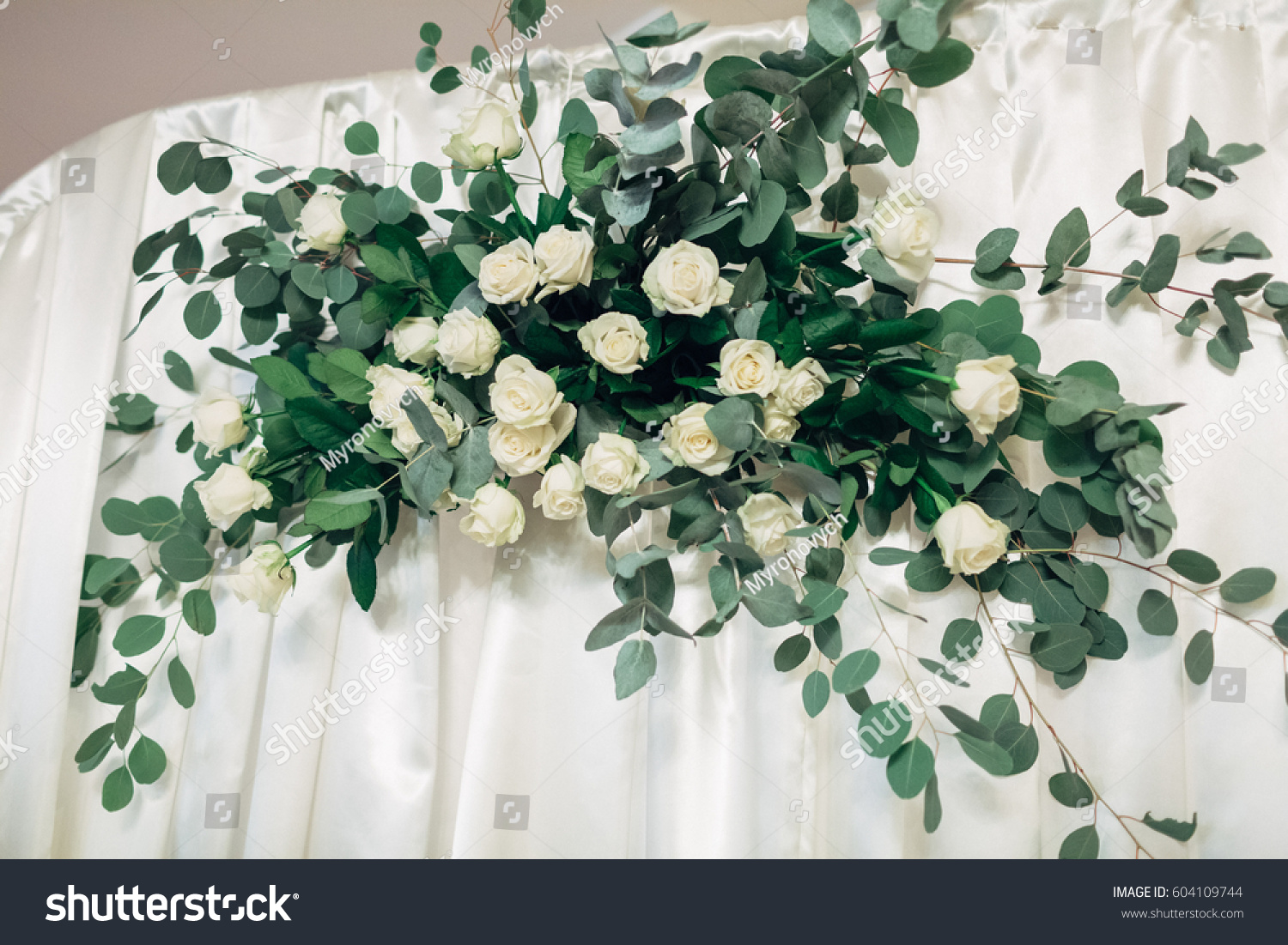 Bouquet of white roses and long green branches stands on little id 604109744 izmirmasajfo