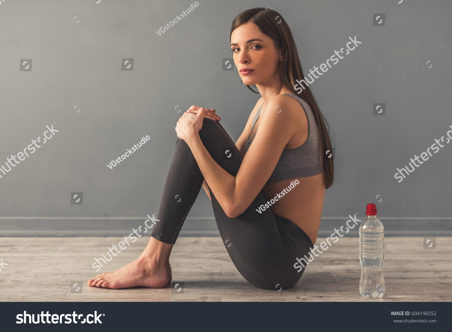 anorex granny Suffering from anorexia. Girl is sitting lonely on the floor, a bottle of  water