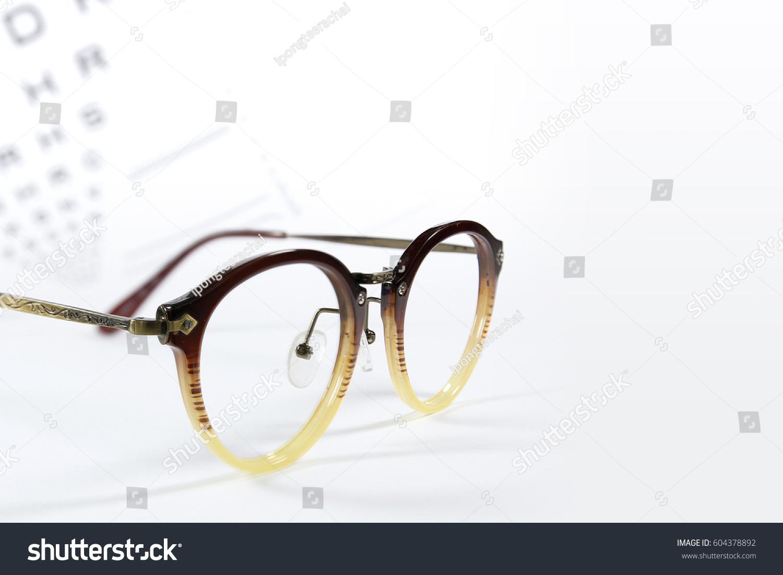Reading Eye Glasses With Eye Chart Isolated On White Ez Canvas