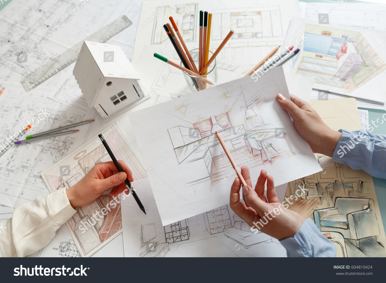 Interior designers working on color hand stock photo for Where do interior designers work