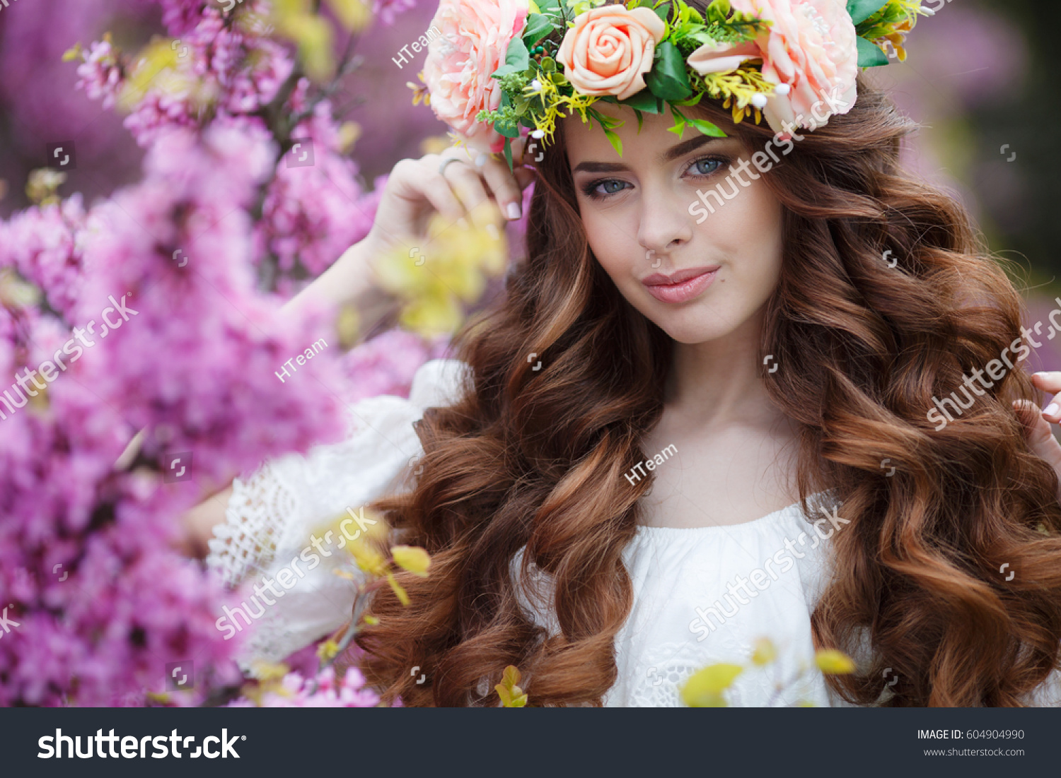 Spring woman flowers beautiful woman flower stock photo safe to use spring woman in flowers beautiful woman with flower wreath portrait of young beautiful woman izmirmasajfo