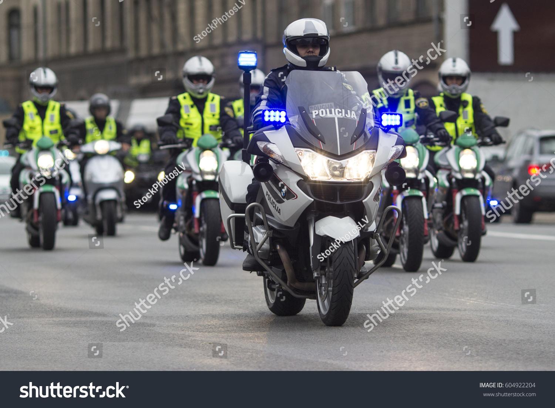 Riga Latvia - May 25, 2013 ; A group of Latvian Police motorcyclists  escorting transport
