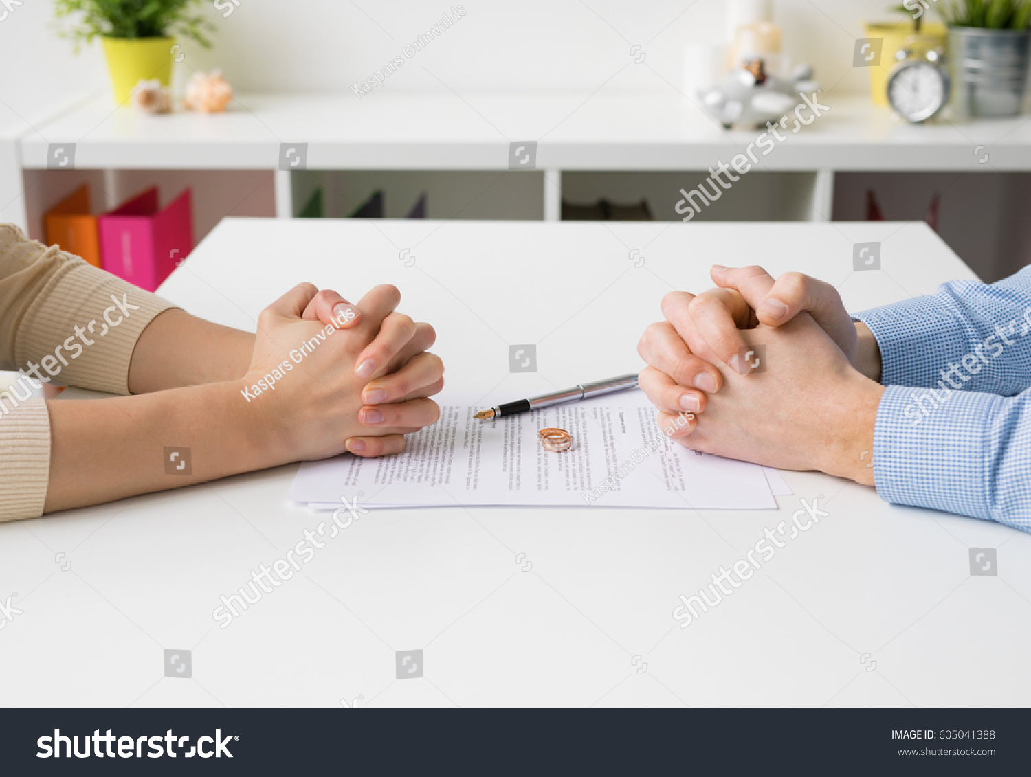 Couple going through divorce signing papers #605041388