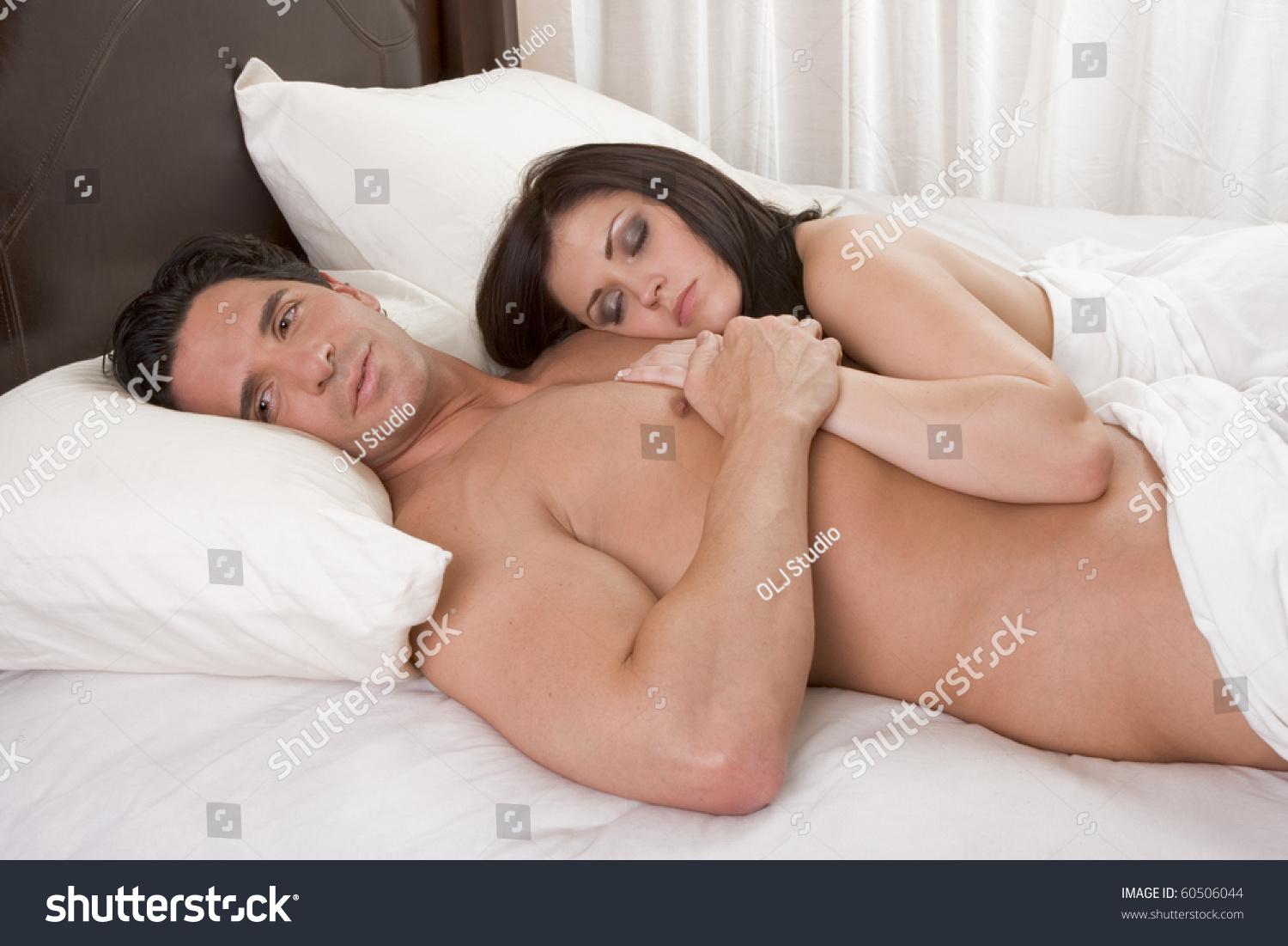 couple sleeping nude