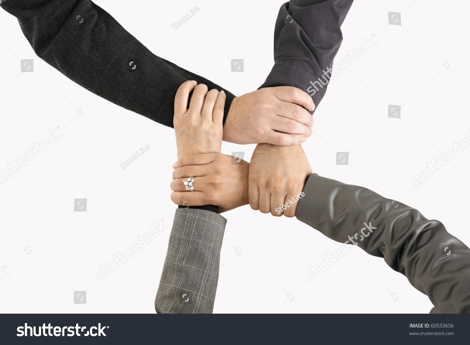Technology Management Image: Businessteam Holding Hands Only Hands Closeup Stock Photo
