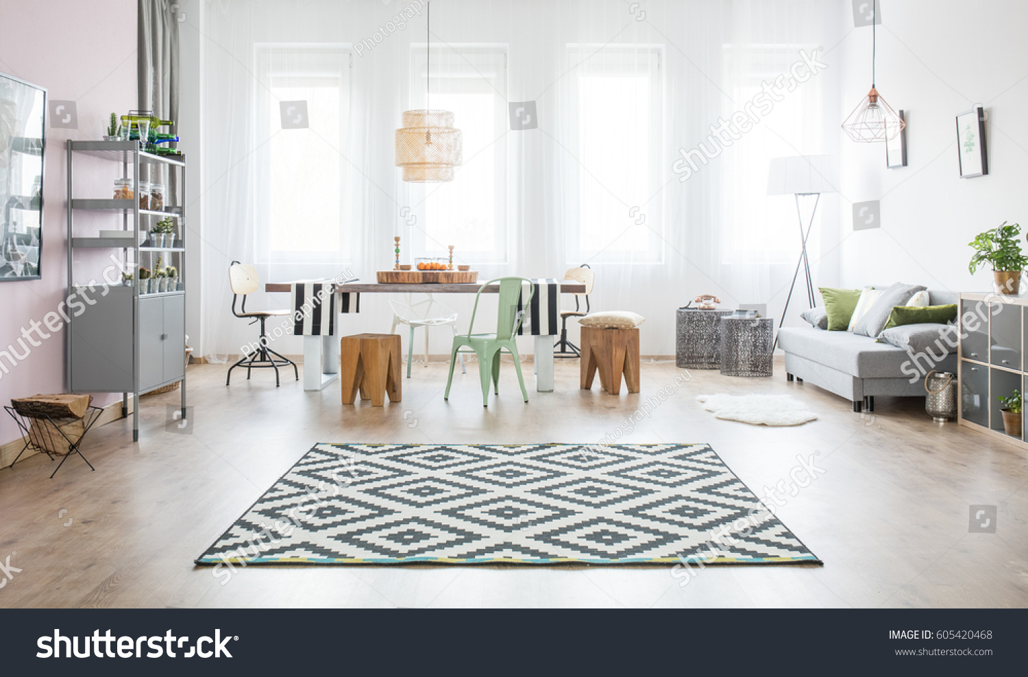 Functional Apartment With Dining Table Sofa And Pattern Rug