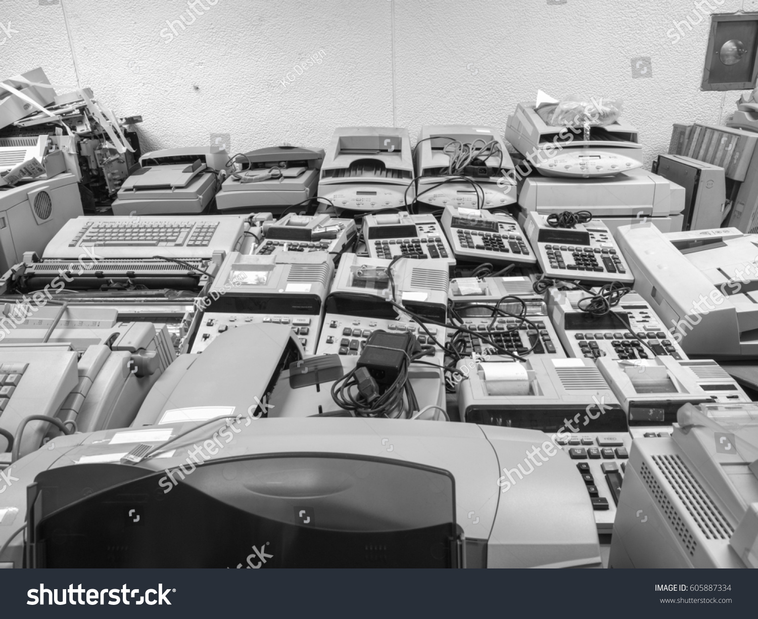 High resolution black and white wide shot of disposed old cashier machines and printers that are waiting for discount sale wide shot of garage sale of old