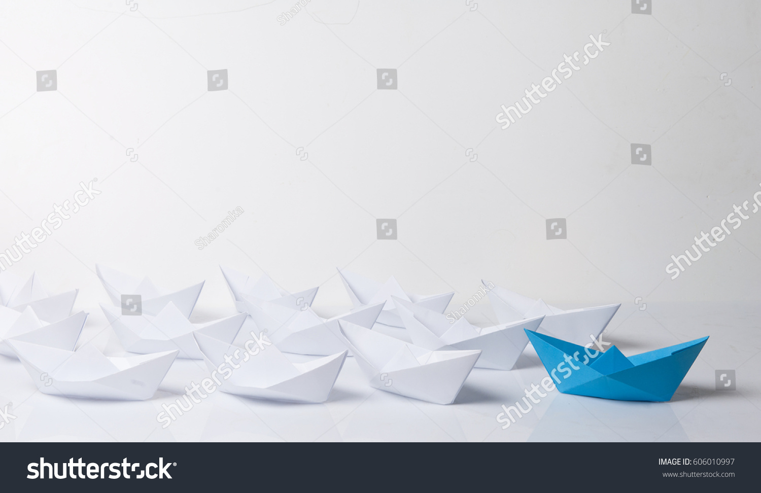 Leadership Concept Blue Paper Boat Leading Among White Ships Set