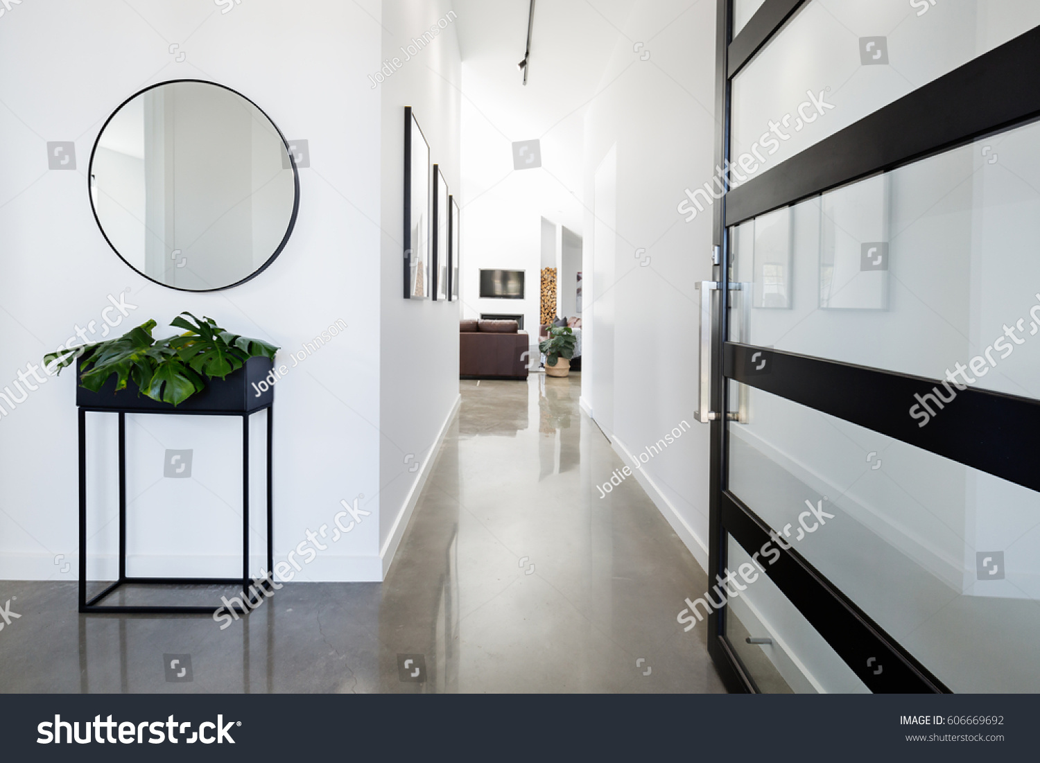 Contemporary Home Entry Hall Polished Concrete Stock Photo (Royalty ...