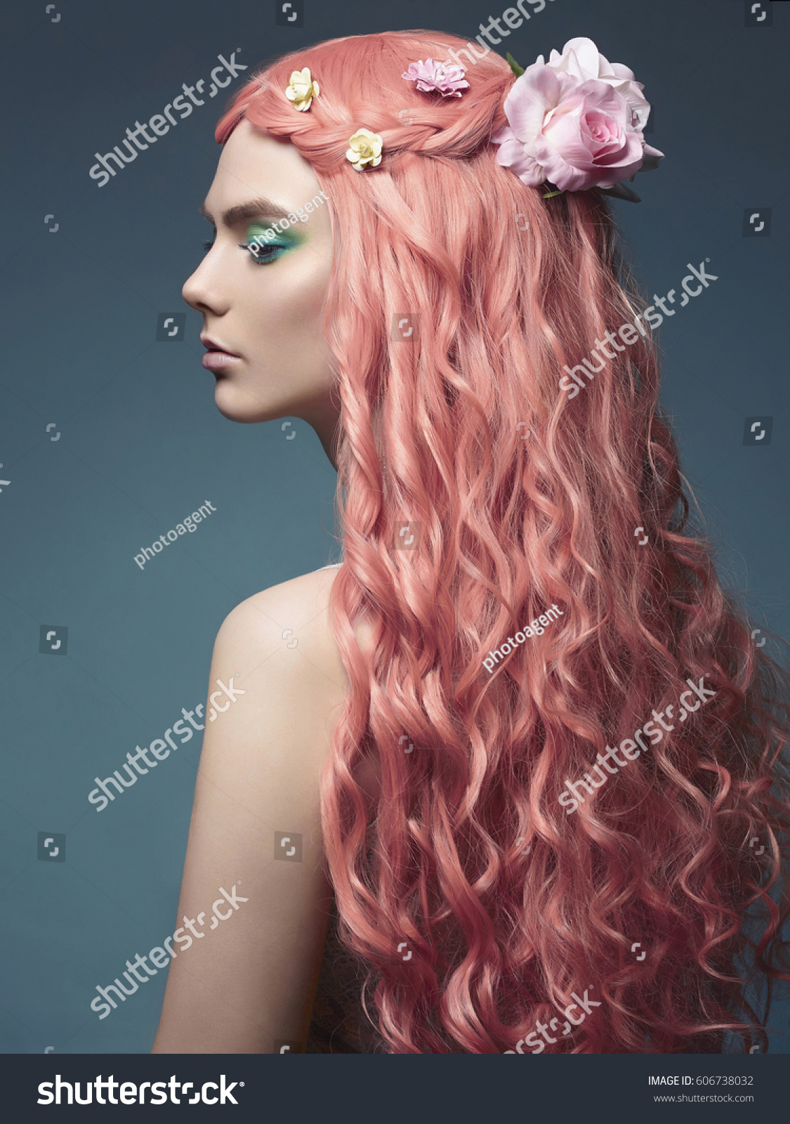 Beautiful girl long pink hair flowers stock photo royalty free beautiful girl with long pink hair and flowers in them fabulous spring portrait of young izmirmasajfo