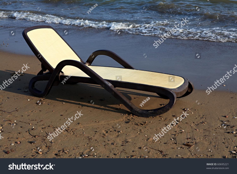 Chaise longue on the beach mediterranean stock photo for Beach chaise longue