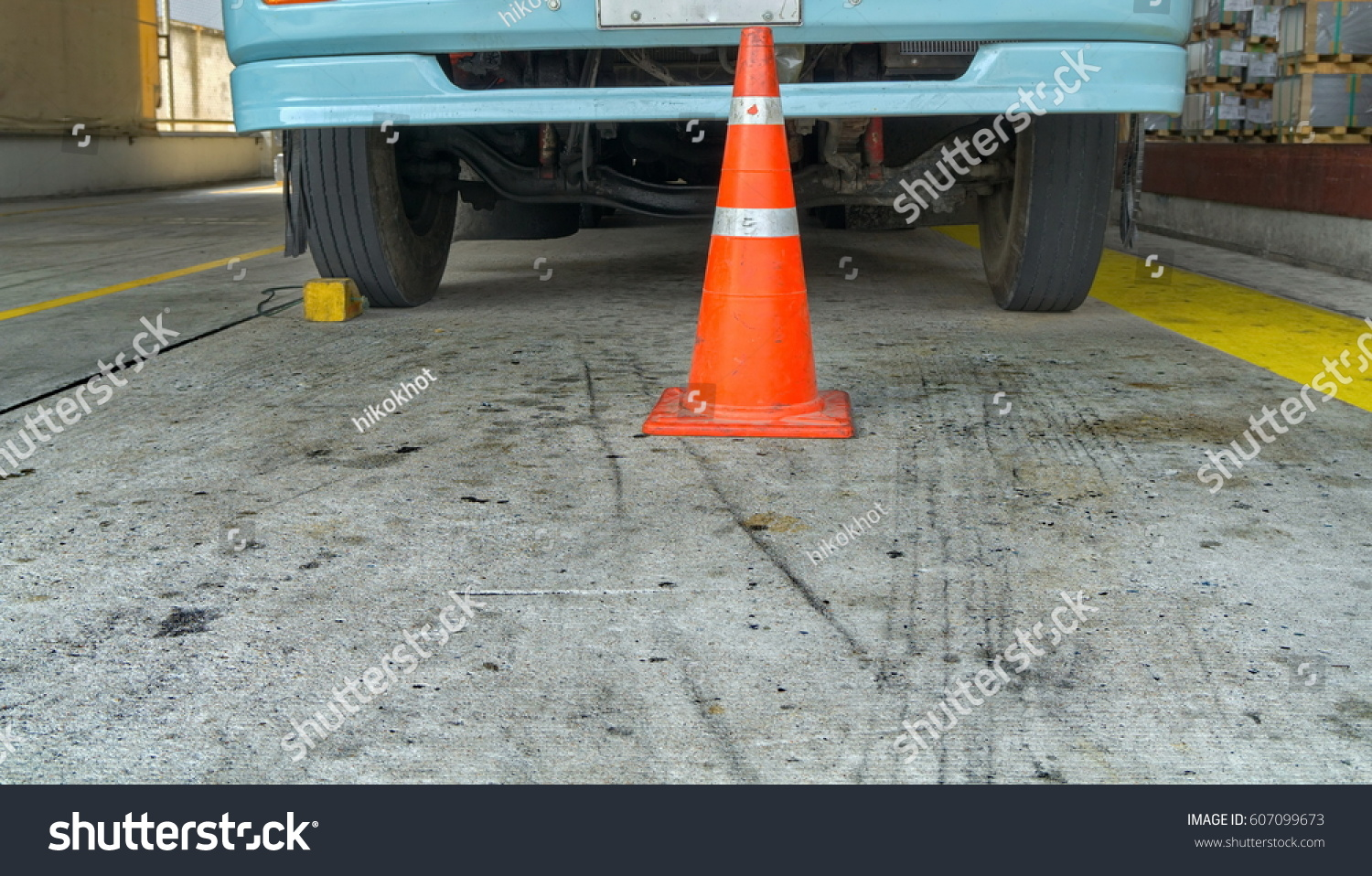 Truck parked with wheel stopper #607099673