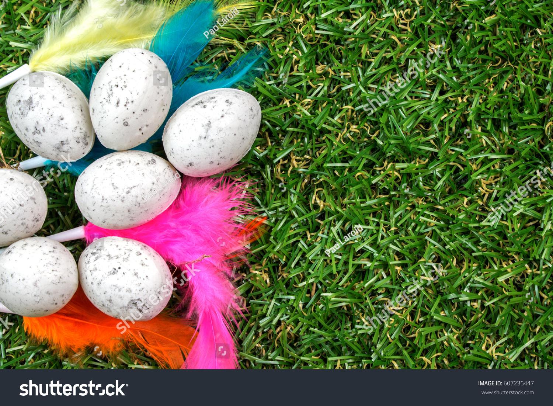 Plastic Easter Eggs On Green Grass Background