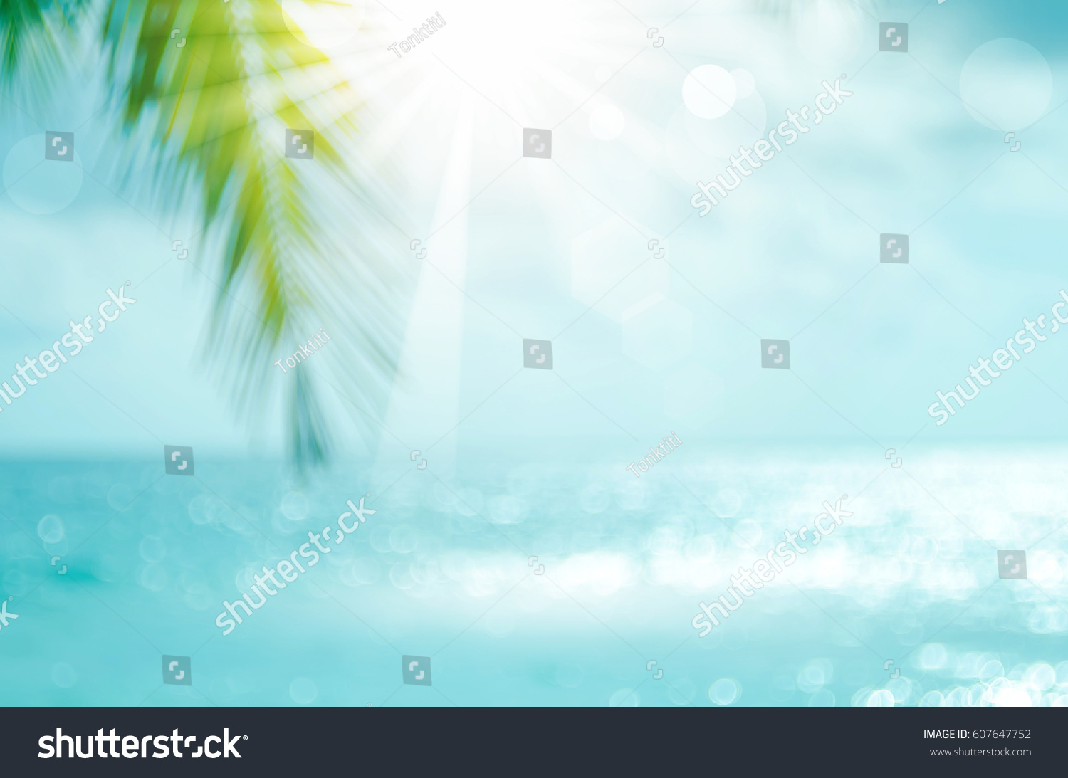 Blur beautiful nature green palm leaf on tropical beach with bokeh sun light wave abstract background. Copy space of summer vacation and business travel concept. Vintage tone filter effect color style #607647752 - 123PhotoFree.com