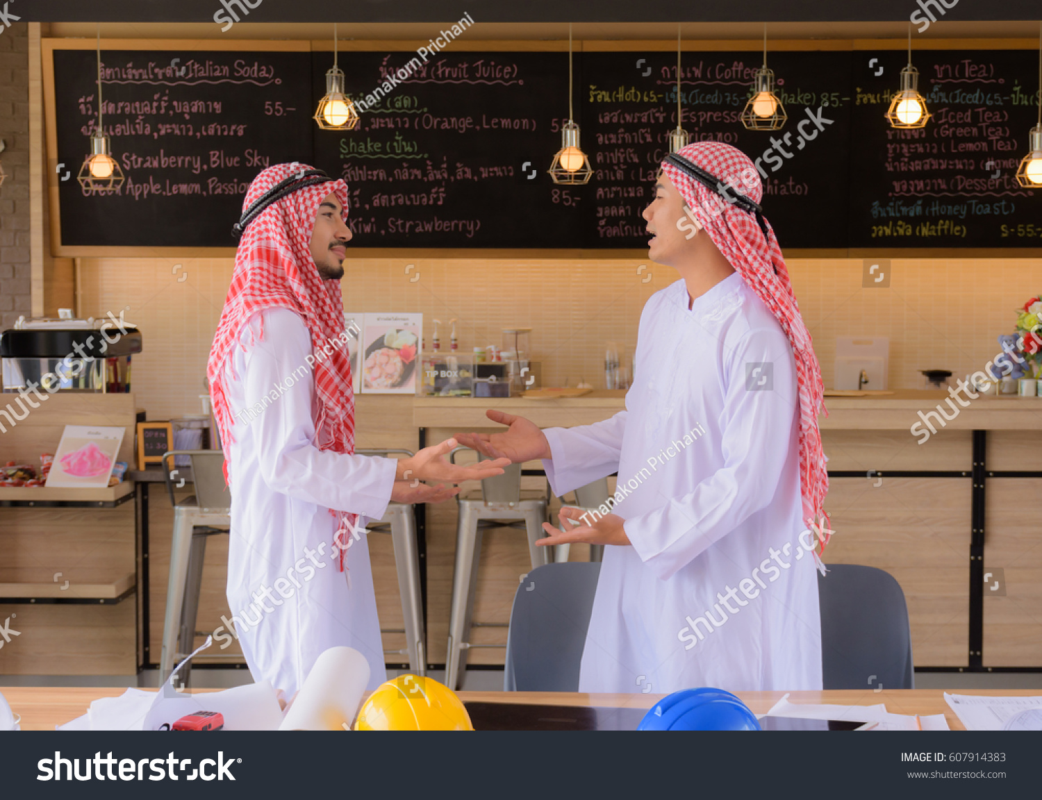Two Arab Businessmen Greet Each Other Stock Photo Edit Now