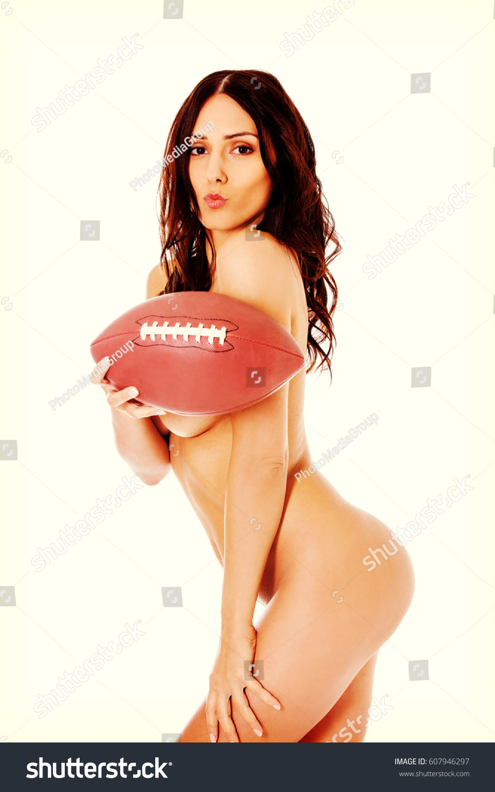 American Football Nude beautiful nude woman holding american football stock photo (edit now