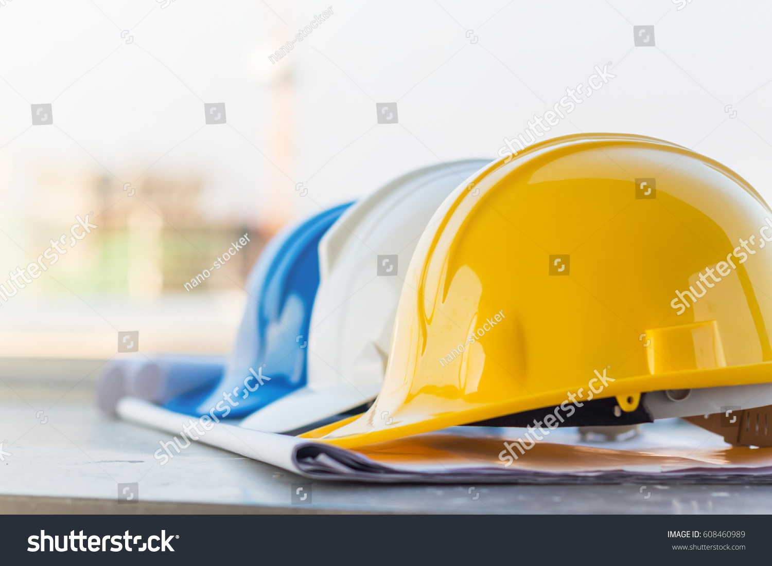 Group safety helmet blueprint construction site stock photo the group of safety helmet and the blueprint at construction site with crane background malvernweather Images