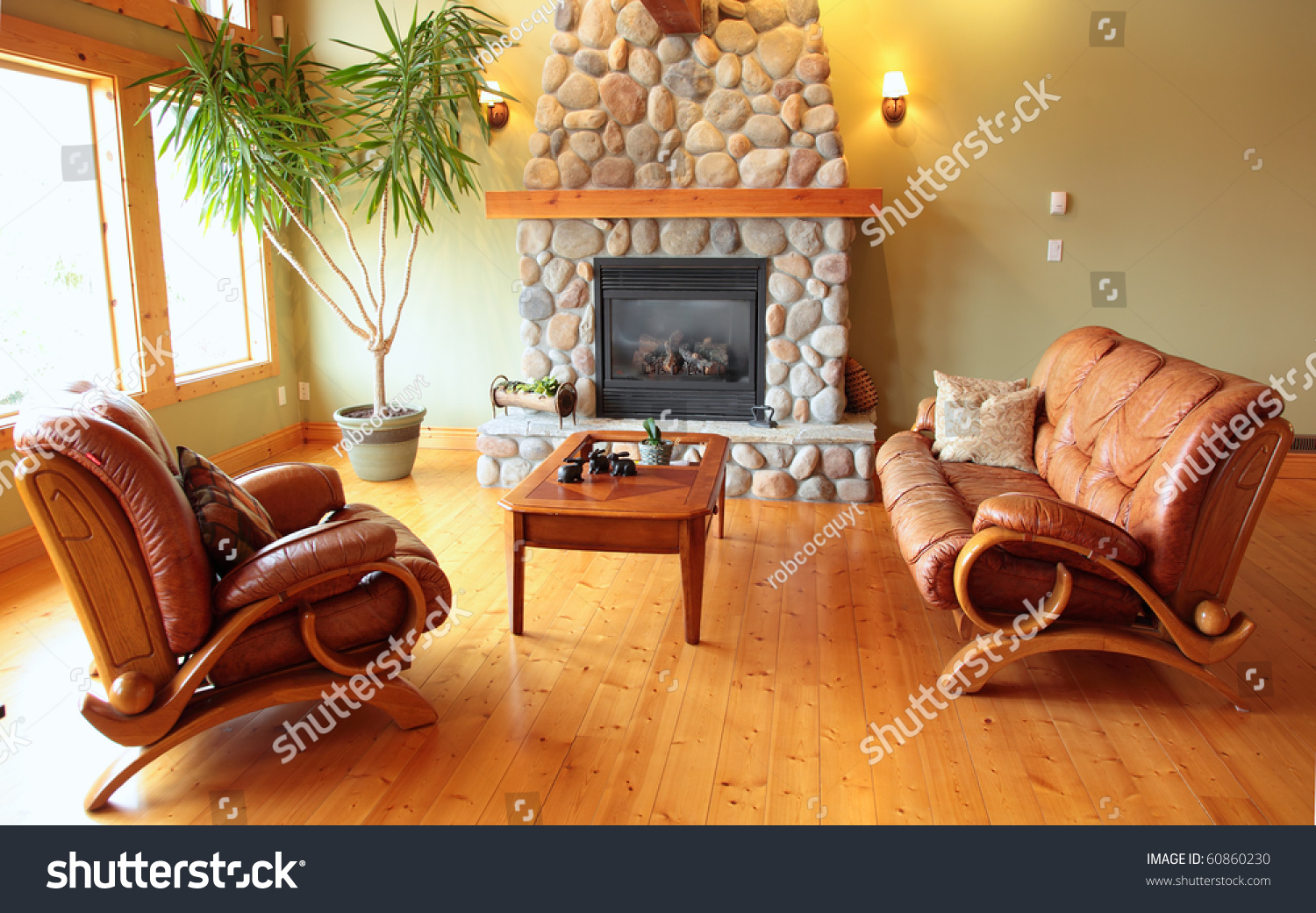 River rock fireplace pictures - A West Coast Living Room With A River Rock Fireplace