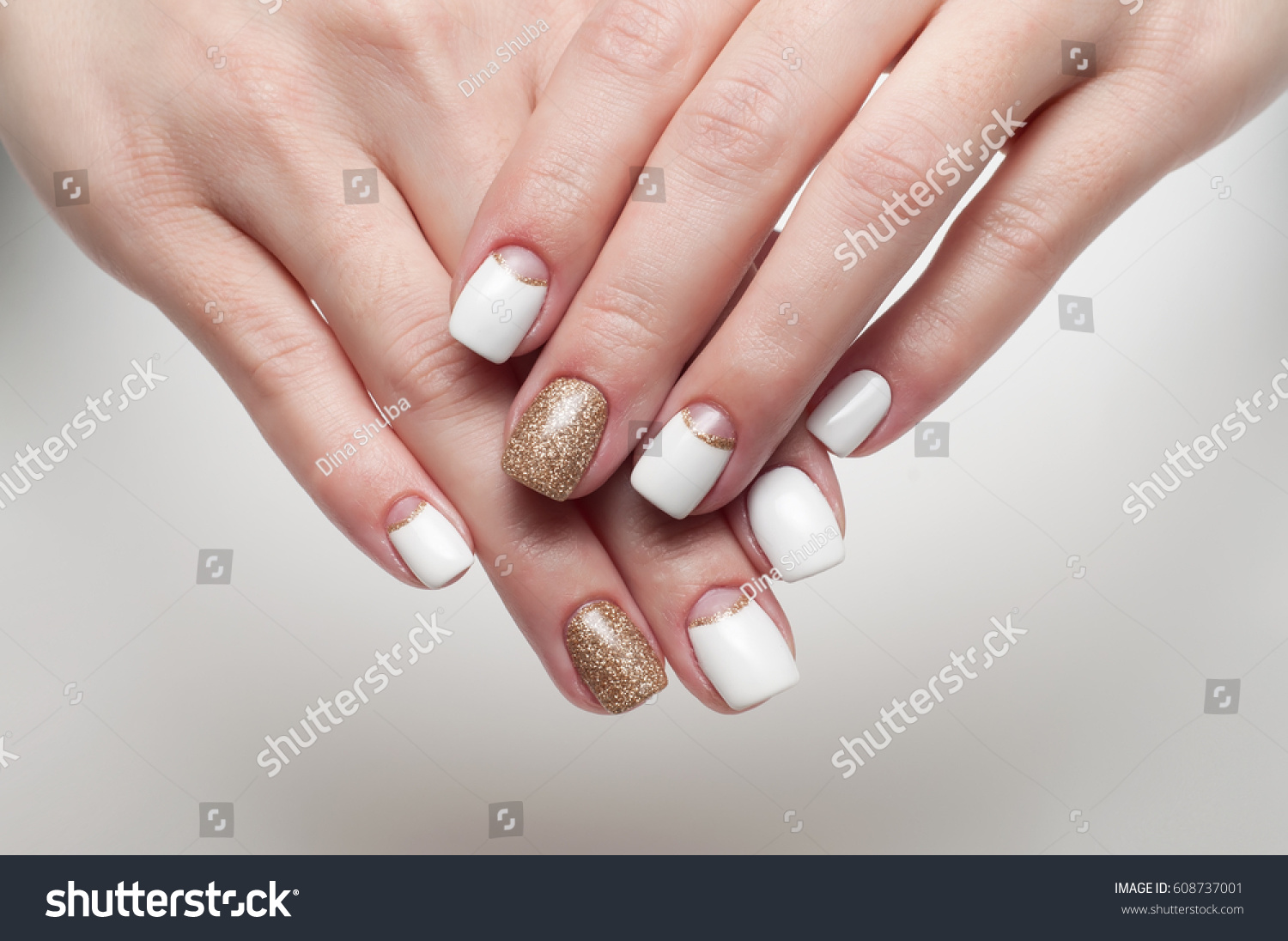 White Golden Manicure On Square Long Stock Photo (100% Legal ...