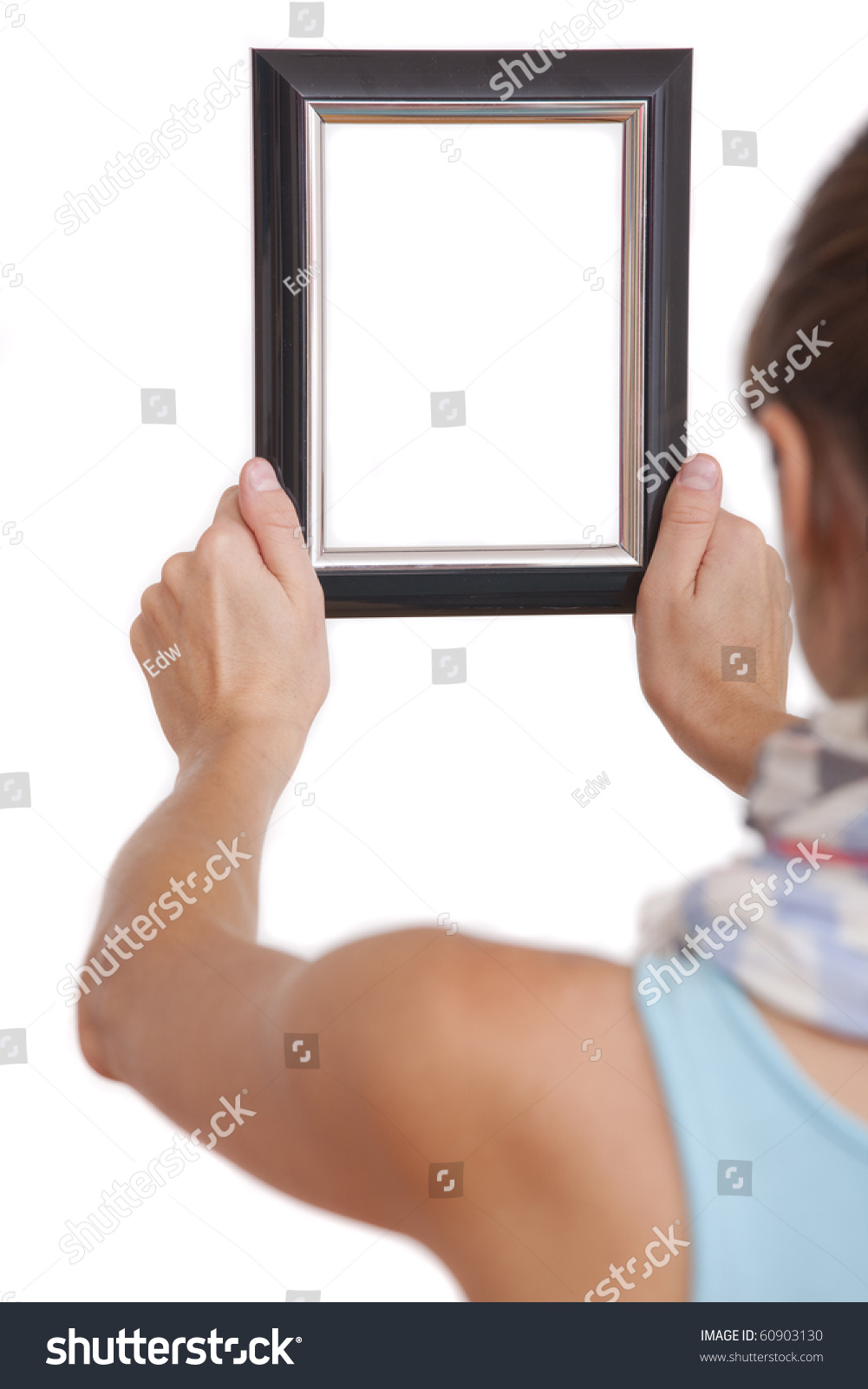 Woman Hanging Photo Frame Focus On Stock Photo (Royalty Free ...