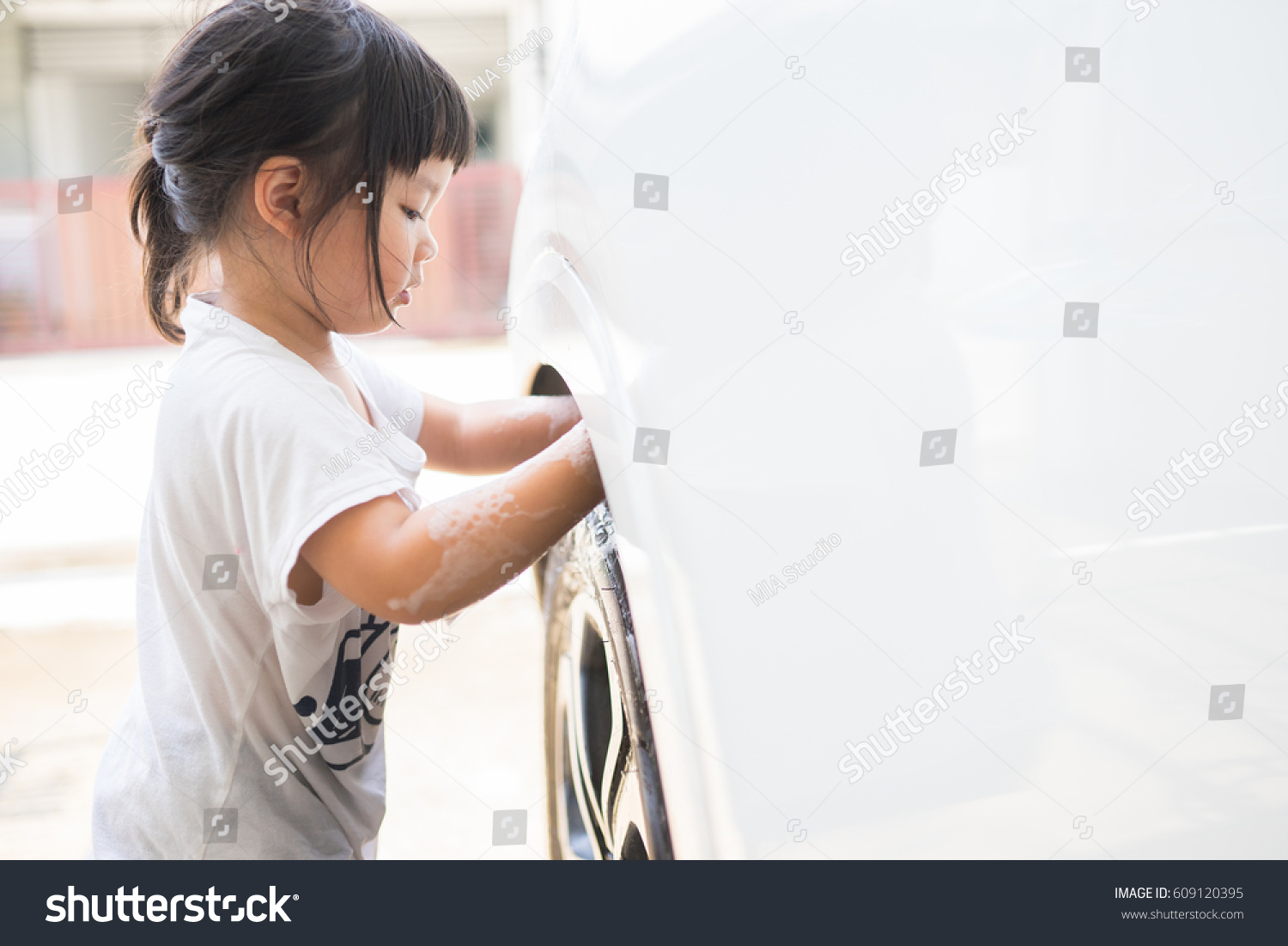 from Reed chinese girl washing a car