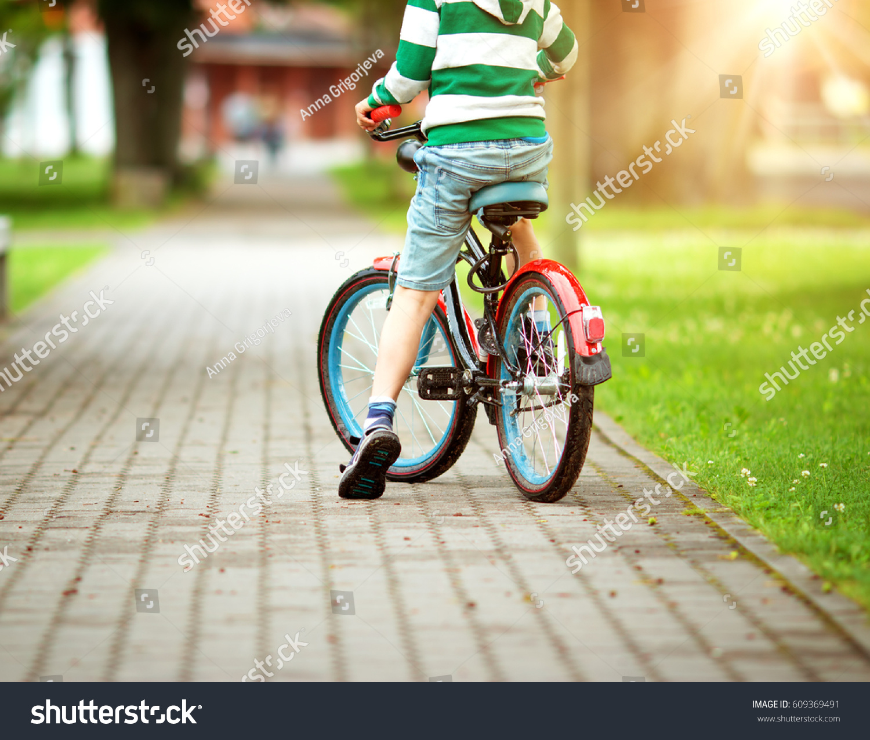Child On Bicycle Asphalt Road Summer Stock Photo 609369491