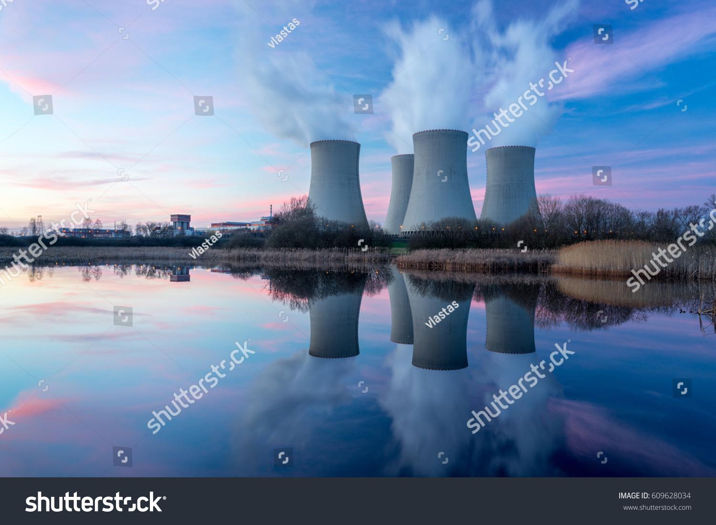 Nuclear power plant after sunset. Dusk landscape with big chimneys. #609628034